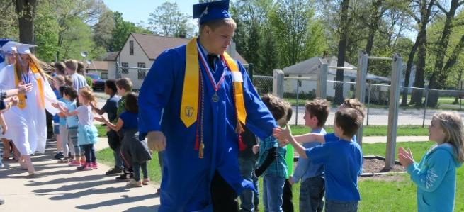 Grads at RRO high fives