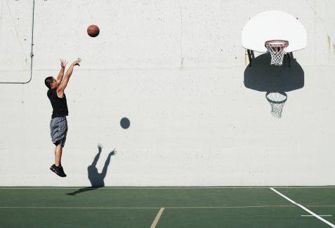 Player shooting at basketball hoop